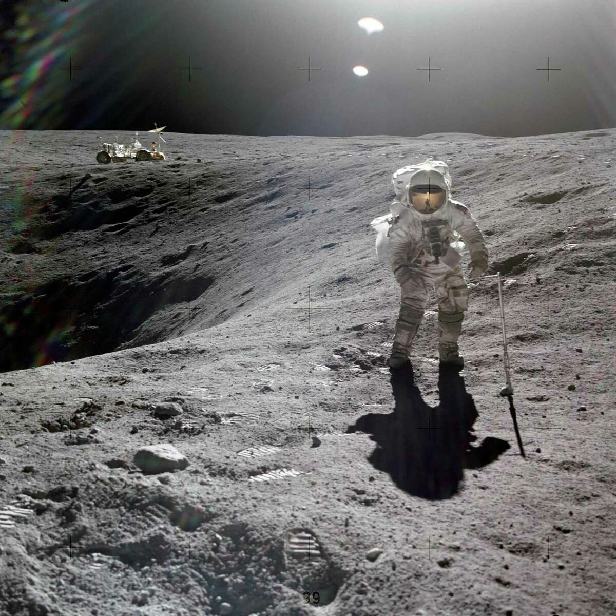 Astronaut Charles M. Duke Jr. collects lunar samples during the first Apollo 16 extravehicular activity at the Descartes landing site on April 21, 1972.
