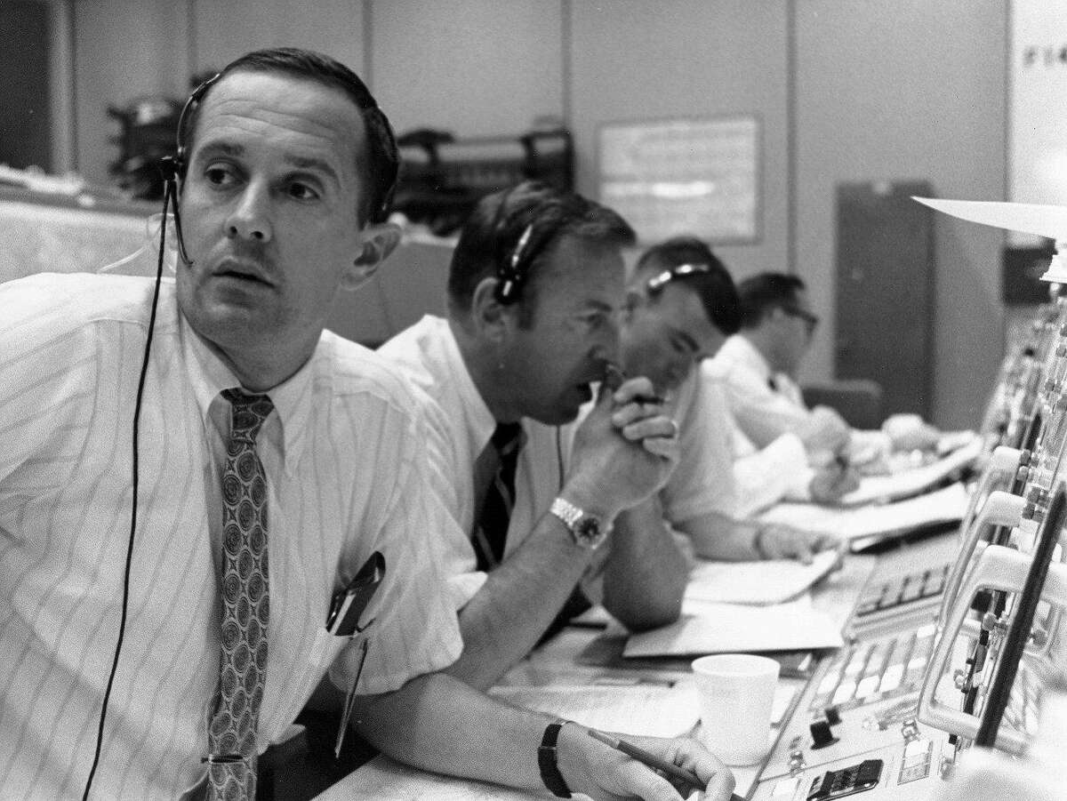 Astronaut Charlie Duke, left, handled communications with the Apollo 11 spacecraft during the moon landing on July 20, 1969. He is shown here in the Mission Control Room at the Johnson Space Center in Houston with backup Commander Jim Lovell (second from left), and backup Lunar Module Pilot Fred Haise.