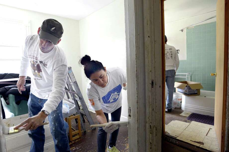Approximately 30 volunteers pitched in to paint, repair plumbing, install new lighting, ceiling fans and smoke/carbon monoxide detectors and renovate the kitchen with new cabinets, counter tops and appliances of Jennifer Humphrey Stamford home during the 30th annual HomeFront Day on May 6, 2017.. HomeFront is a community-based program dedicated to providing quality of life improvements to families with financial hardships. Since 1988, HomeFront volunteers have repaired over 3000 homes, injecting nealy $50 million of assistance where it is needed most. Photo: Matthew Brown / Hearst Connecticut Media / Stamford Advocate