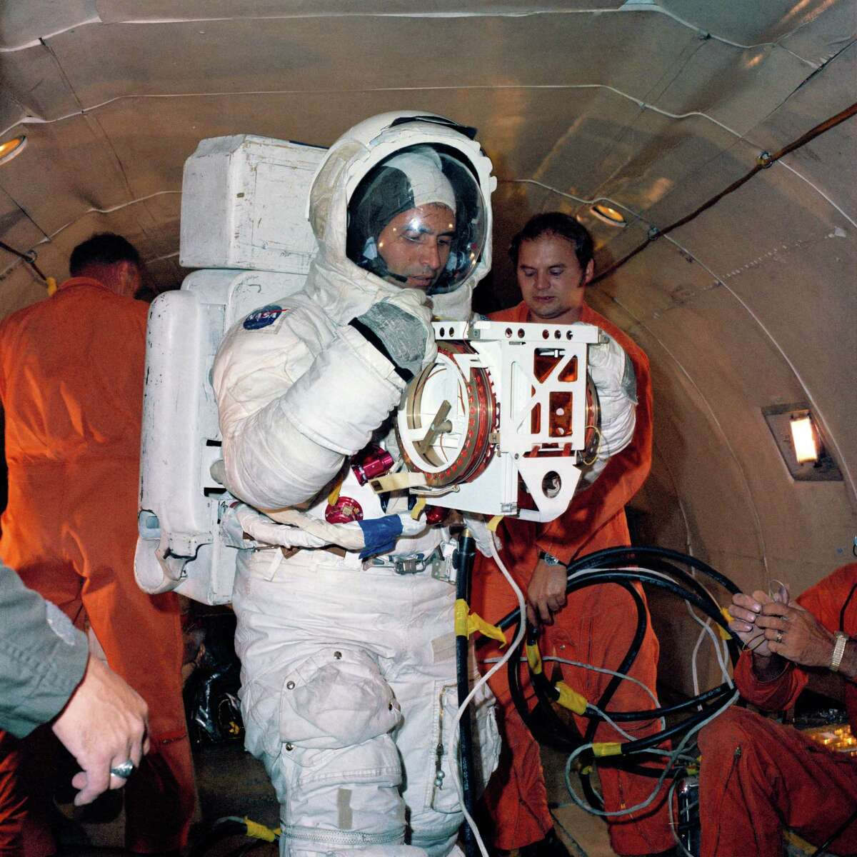 Scientist-astronaut Harrison H. Schmitt, lunar module pilot of the Apollo 17 lunar landing mission, is shown in this September 1972 photo in a simulation training exercise in low-gravity conditions aboard U. S. Air Force KC-135 aircraft.