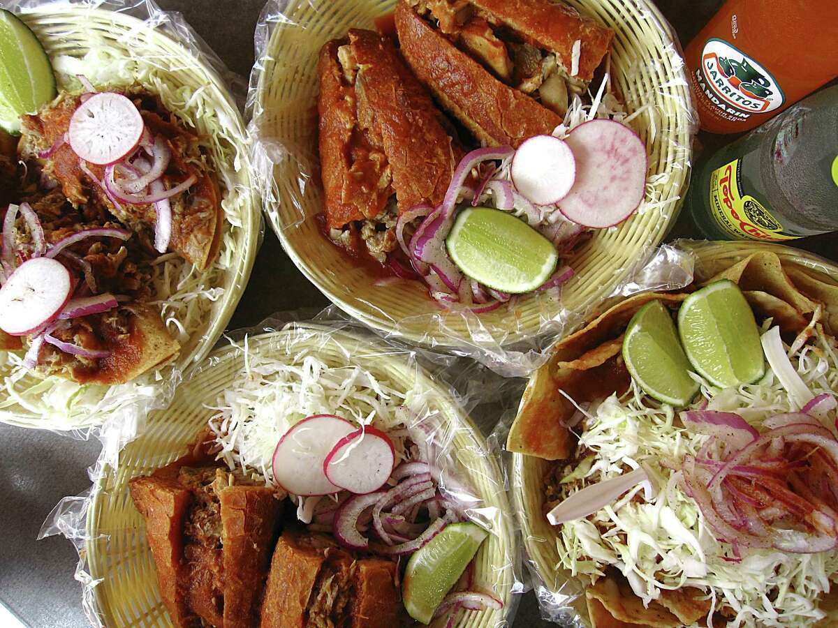 The menu at Ro-Ho Pork & Bread includes, clockwise from top left, tacos dorados with carnitas, a torta ahogada with pork stomach called buche, nachos with carnitas and buche and the signature torta ahogada with pork carnitas.