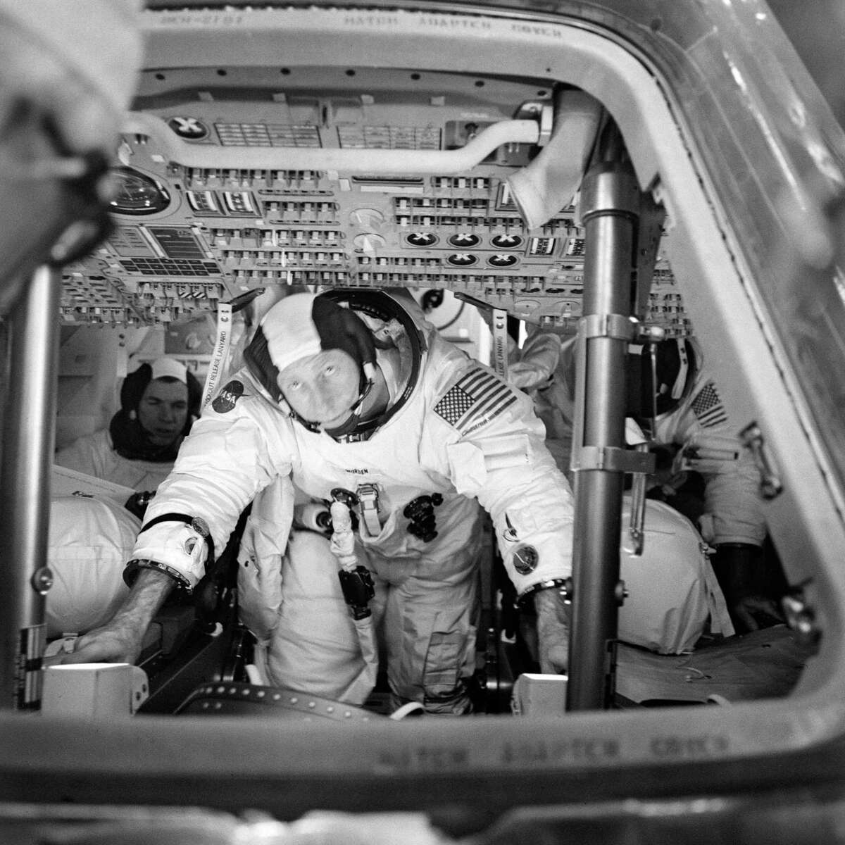 The three Apollo 15 crew members can be seen inside the Command Module on March 26, 1971 during simulation training at the Kennedy Space Center. Astronaut David R. Scott, commander, is in the background to the left. Astronaut Alfred M. Worden, center foreground, is the command module pilot. Out of view, to the right background, is astronaut James B. Irwin, lunar module pilot.