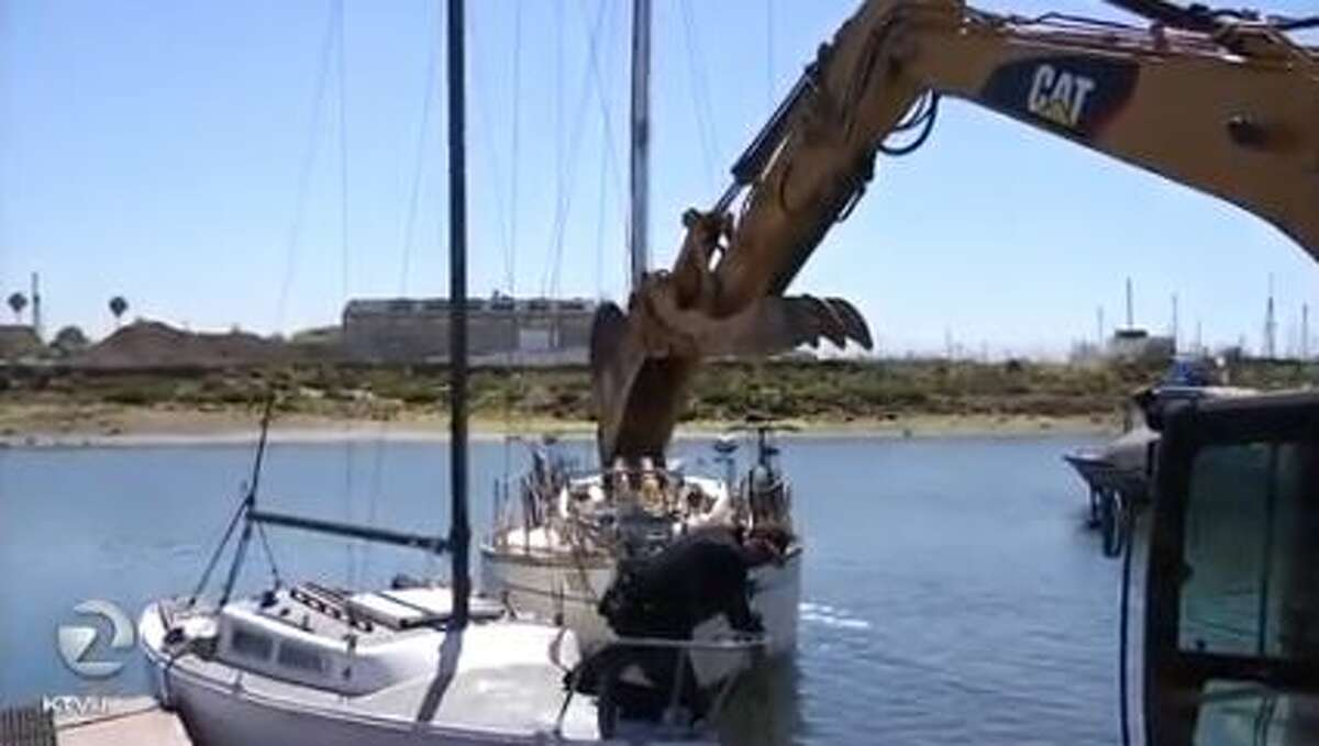 Oakland and Alameda police teamed up to remove ships from the Oakland estuary on Wednesday. A backhoe was used to demolish the boats and prepare them for the landfill.