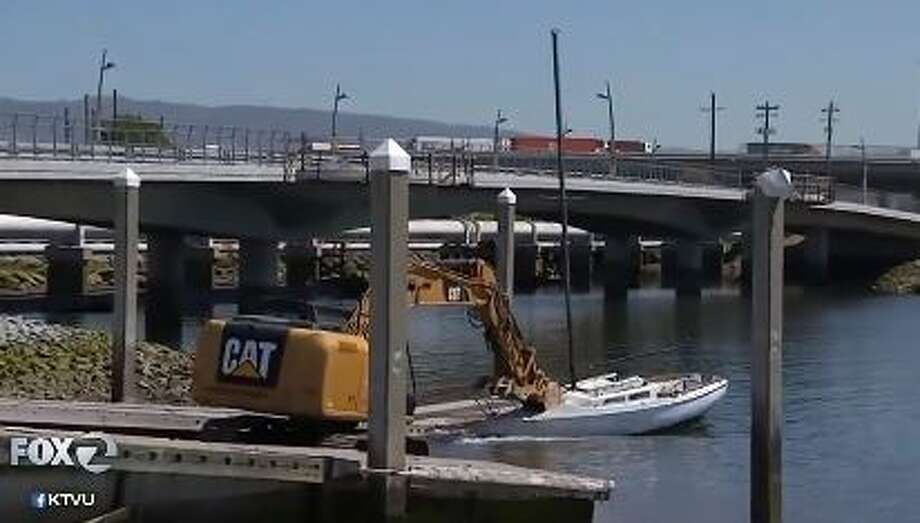 Oakland and Alameda police teamed up to remove ships from the Oakland estuary on Wednesday. A backhoe was used to demolish the boats and prepare them for the landfill. Photo: KTVU