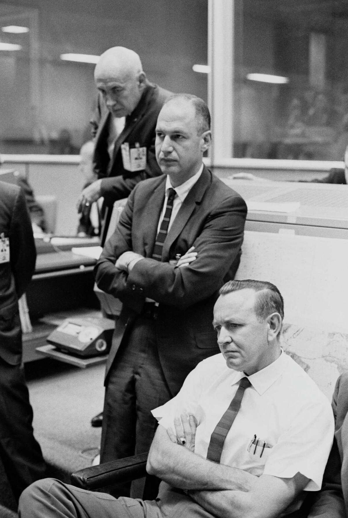 The faces of key officials register disappointment on Oct. 25, 1965 after the Gemini-Titan 6 mission was canceled due to the apparent failure of the unmanned Agena Target Vehicle to attain orbit. Shown, front to back, Robert R. Gilruth, George M. Low and Christopher C. Kraft Jr.
