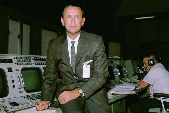 Christopher C. Kraft Jr. is seen at his flight director console in the Mission Control Center during a Gemini-Titan V flight simulation. in the mid-1960s.