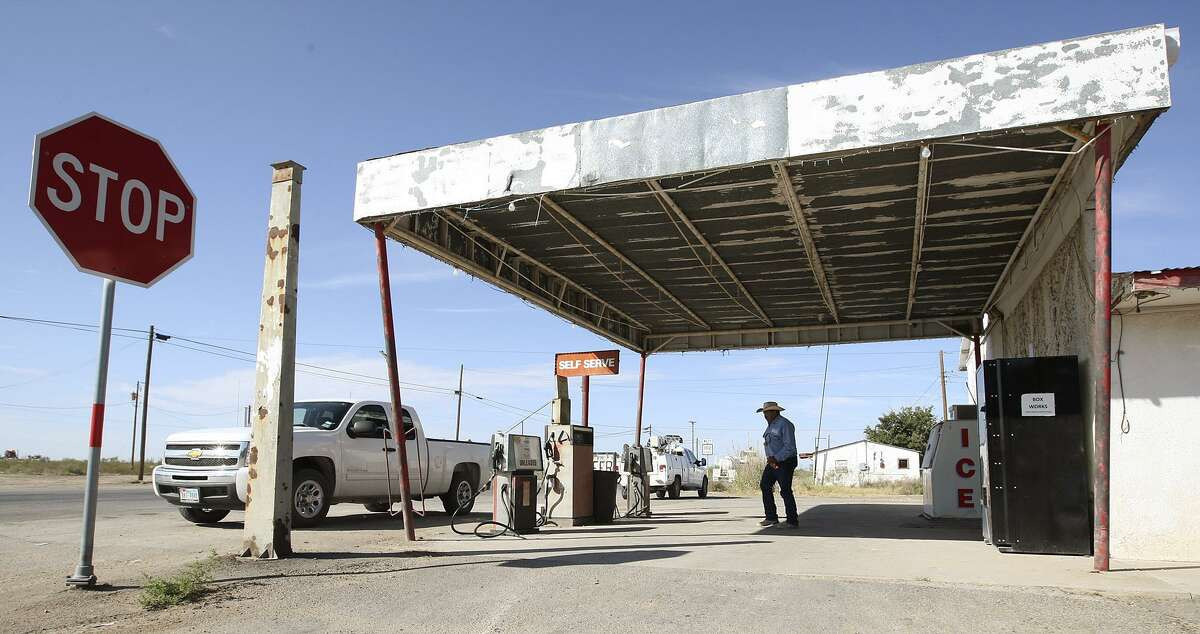 A customer leaves the only business in Loving County, Texas, Wednesday, July 25, 2012. Located in Mentone, Texas 130 miles west of Midland, the convenience store serves locals and oil field workers.