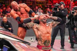 Triple H, left, grapples with Batista during WrestleMania 35 at MetLife Stadium in East Rutherford, New Jersey, on April 7, 2019.