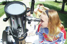 Julianna Rowland, of Godfrey, peers at the sun through a six-inch reflecting telescope during a College for Kids program at Lewis and Clark Community College last year. The annual summer enrichment program offers a number of classes for children kindergarten through high school. Registration for this years College for Kids programs is now under way. For more information, including how to register, call 618-468-5701 or visit www.lc.edu/C4K.