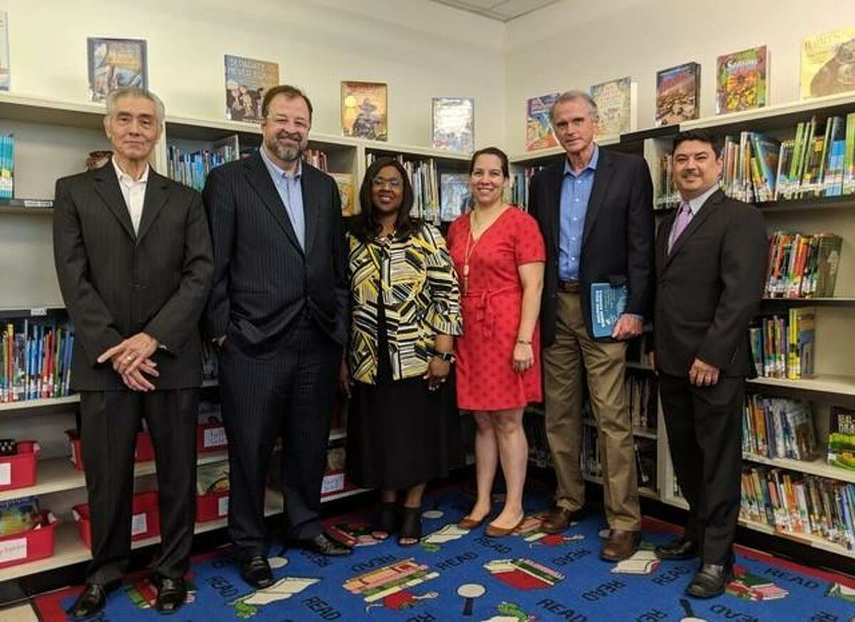 Pictured here are Field Elementary Principal John Hendrickson; Children At RiskPresident & CEO Dr. Bob Sanborn; HISD Interim Superintendent Dr. Grenita Lathan; Children At Risk Director of Research-Center for Social Measurement & Evaluation Kellie O'Quinn; The Robert and Janice McNair Foundation Director of Community Outreach Dr. Dave Peterson; and HISD Northwest Area Superintendent Jorge Arredondo.