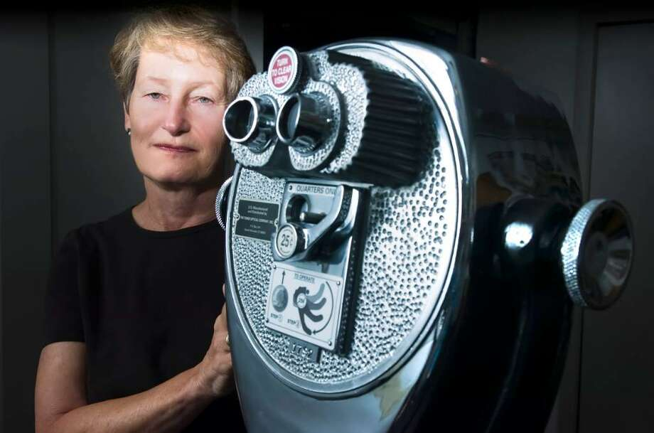 Tower Optical President Bonnie Rising with a binocular viewer device in the company's Norwalk headquarters Tuesday, July 27, 2010. Tower Optical, a family-owned and operated business, was established in 1932. Photo: Keelin Daly / Stamford Advocate