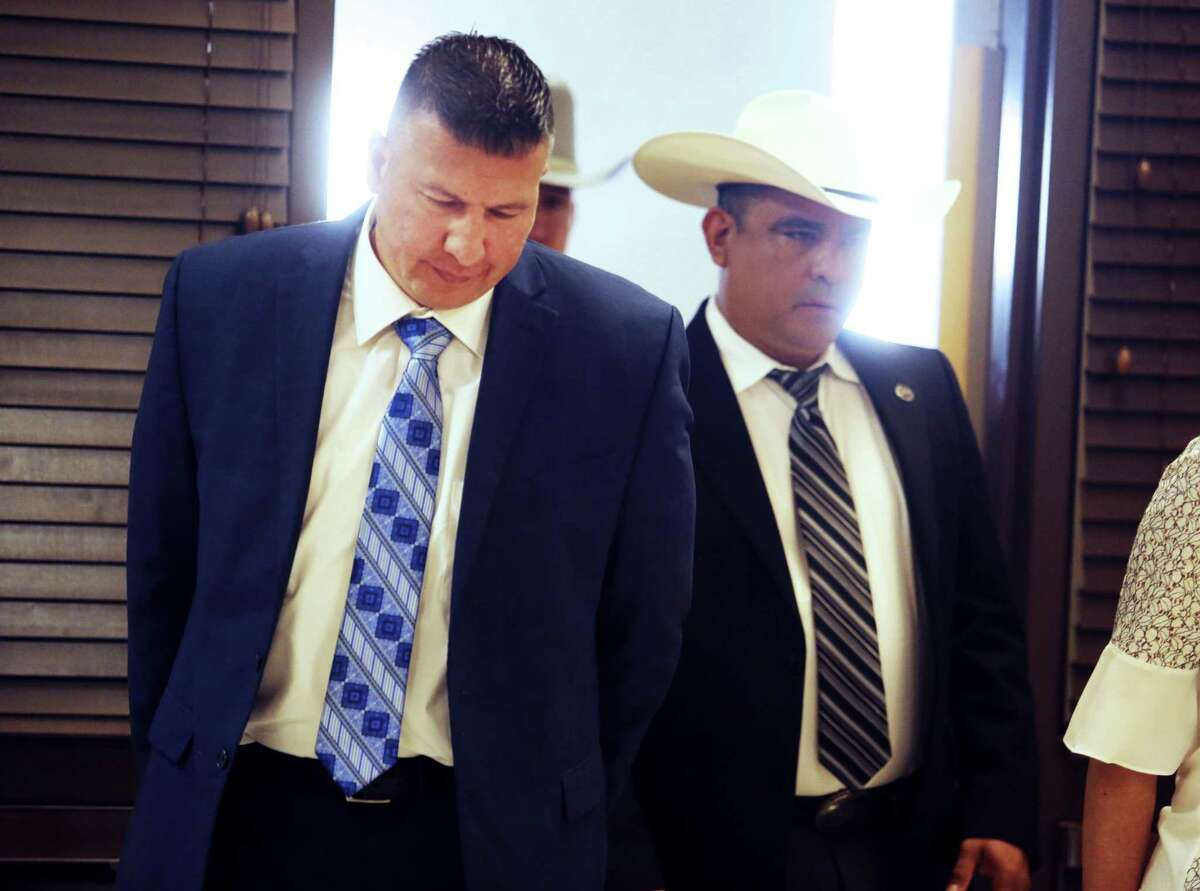 """Edinburg Mayor Richard Molina walks into the courtroom before being arraigned by Justice of the Peace Precinct 2 Jaime """"Jerry"""" Muñoz on charges of trying to rig his own 2017 election victory, Thursday, April 25, 2019, in Pharr, Texas. (Richard Molina/The Monitor via AP)"""