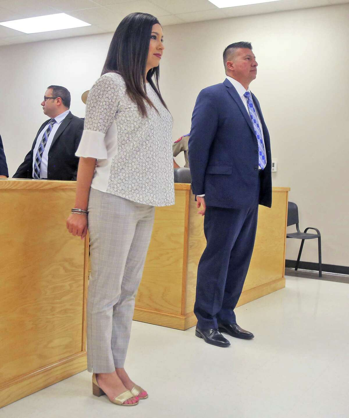 """Edinburg, Texas Mayor Richard Molina and his wife Dalia Molina are arraigned before Justice of the Peace Precinct 2 Jaime """"Jerry"""" Muñoz on illegal voting and engaging in organized election fraud charges on Thursday, April 25, 2019, in Pharr, Texas. (Richard Molina/The Monitor via AP)"""