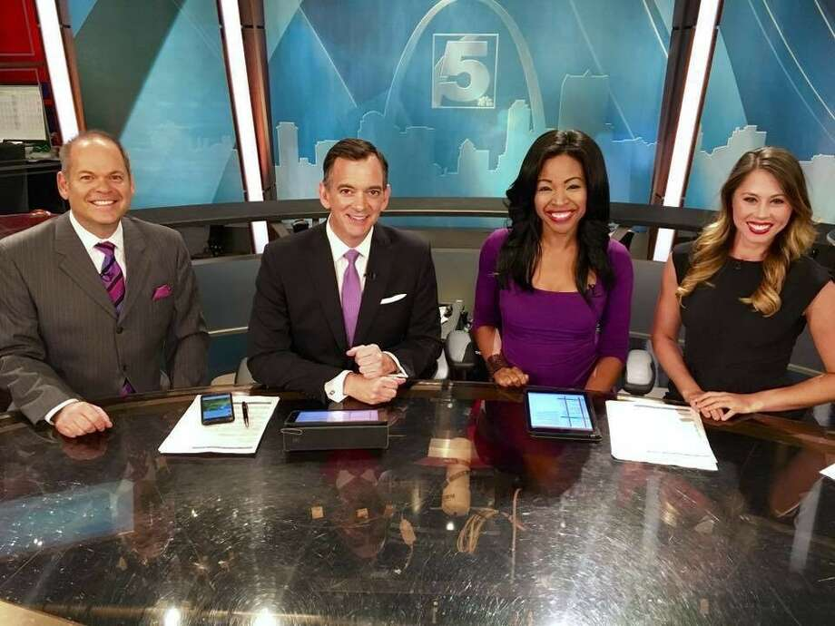Coleman (in purple dress) on the anchor desk with her  KSDK-TV family. Photo: Christina Coleman