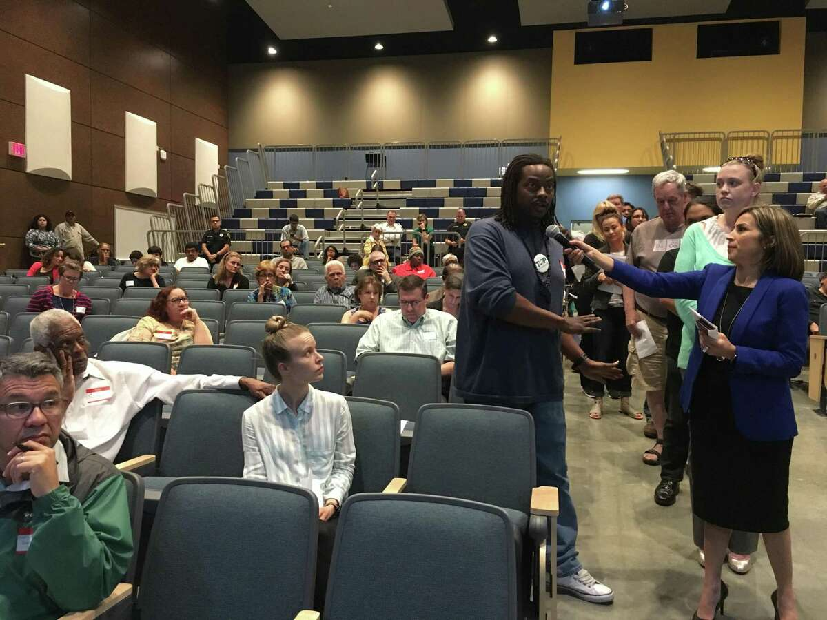 Ebunoluwa Akinola, with Texas Organization Project and an area resident, asks the state and federal agencies about compensation for the community saying he had been diagnosed with bronchitis days after the March 17 ITC fire. Some residents expressed concerns about the lack of information after a chemical incident such as the fire at ITC.