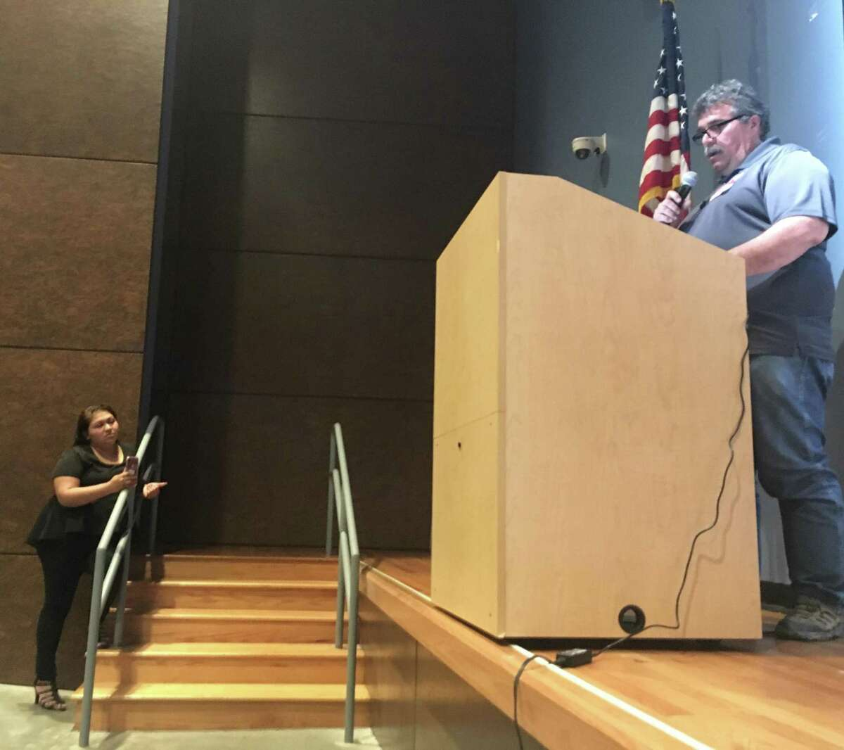 Norma Mottu' interrupts Gary Moore, with the Environmental Protection Agency, to raise questions about air monitoring and potential health effects for the community during a town hall meeting held Wednesday April 24, 2019 at Milby High School in southeast Houston to update the public about the ITC fire.