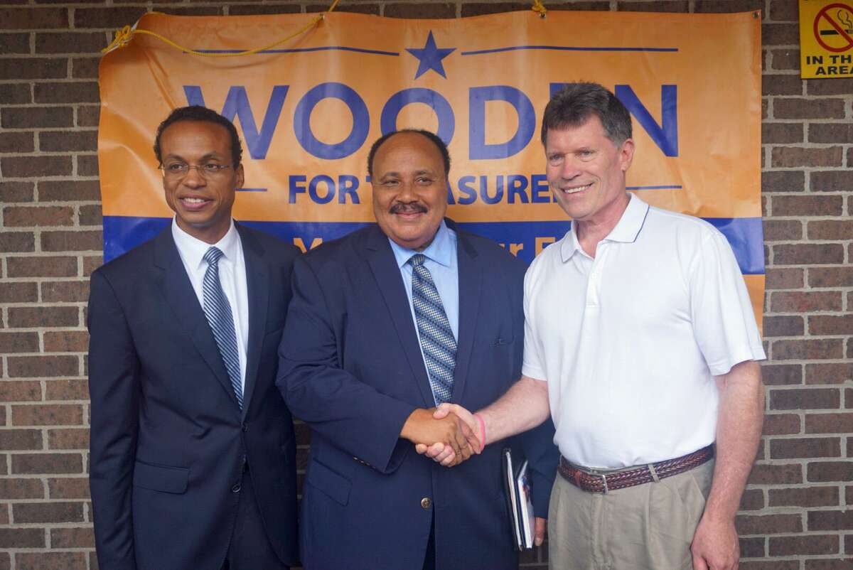 State Sen. John Fonfara, shown at right with Treasurer Shawn Wooden, left, and Martin Luther King III during the 2018 campaigns, is working with Gov. Ned Lamont and other top legislators on a plan to replace the state income tax with a payroll tax, saving Connecticut residents more than $1 billion.