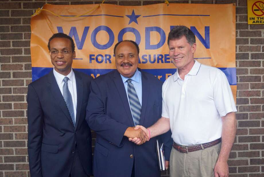 State Sen. John Fonfara, shown at right with Treasurer Shawn Wooden, left, and Martin Luther King III during the 2018 campaigns, is working with Gov. Ned Lamont and other top legislators on a plan to replace the state income tax with a payroll tax, saving Connecticut residents more than $1 billion. Photo: Emilie Munson / Hearst Connecticut Media / Connecticut Post