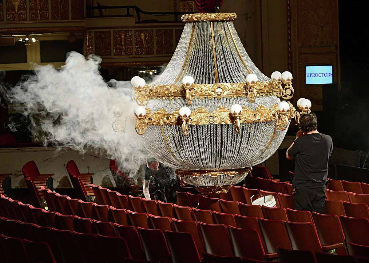 Stage crew members works on the Phantom of the Opera chandelier before a matinee of the production at Proctors on Thursday, April 25, 2019 in Schenectady, N.Y. (Lori Van Buren/Times Union) m