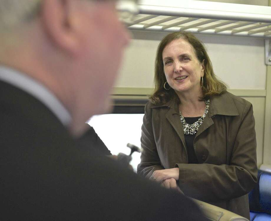 Metro-North Railroad President Catherine Rinaldi listens to Bethel First Selectman Matt Knickerbocker on the 9:05 a.m. train to South Norwalk on Thursday. Photo: H John Voorhees III / Hearst Connecticut Media / The News-Times