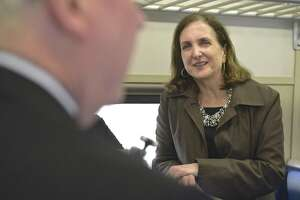 Metro-North Railroad President Catherine Rinaldi listens to Bethel First Selectman Matt Knickerbocker on the 9:05 a.m. train to South Norwalk on Thursday.