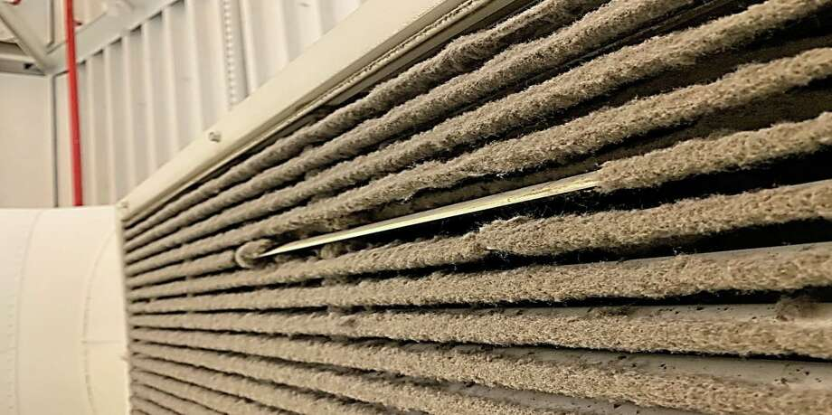 Mold buildup on an air vent at Westhill High School in Stamford. One small strip is cleaned off to show the extent of the infestation. Photo: Contributed Photo/Stamford Public Schools / Contributed Photo/Stamford Public Schools / Stamford Advocate Contributed