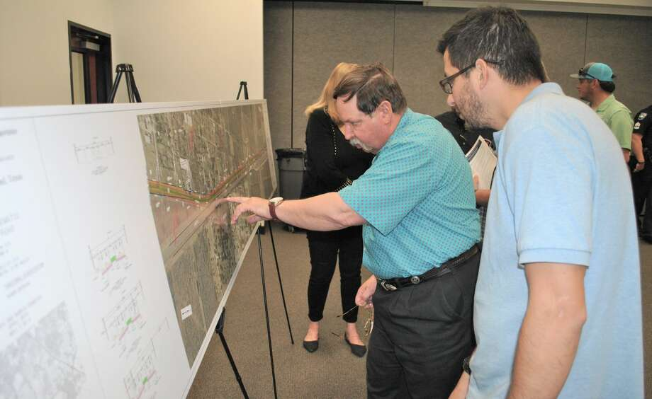Phil Barnes, a consultant with a firm hired by the Texas Department of Transportation, discusses proposed Mykawa Road improvements with Pearland resident Kip Prado. Photo: Tyler Johnson/For The Chronicle