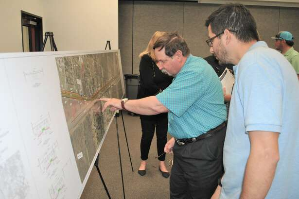 Phil Barnes, a consultant with a firm hired by the Texas Department of Transportation, discusses proposed Mykawa Road improvements with Pearland resident Kip Prado.
