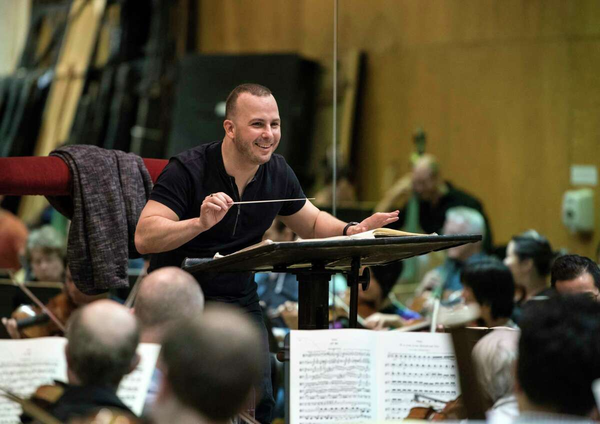 This March 30, 2017 photo released by the Metropolitan Opera shows Yannick Nezet-Seguin during a rehearsal in New York. Yannick Nezet-Seguin conducts his first performance as only the third music director in the Metropolitan Opera?s 135-year history when he takes the podium Tuesday night for the opening of a new production on Verdi?s ?La Traviata? by the Tony Award-winning director Michael Mayer. (Jonathan Tichler/Metropolitan Opera via AP)