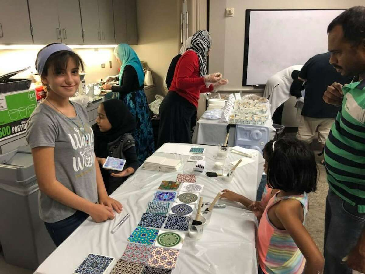 """Using a backdrop of interactive stations, posters, speakers and offerings of food, face painting for kids, the """"Know Your Muslim Neighbor"""" event is an open invitation to learn about Islam and the role Muslims play in America culture."""
