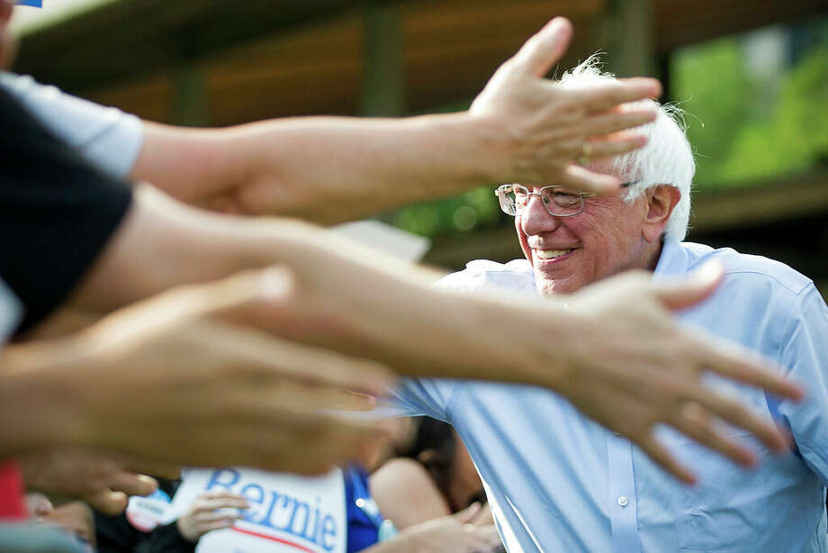 Democratic presidential candidate Sen. Bernie Sanders, I-Vt., reaches out to supporters before speaking at a rally at Discovery Green on Wednesday. Photo: Houston Chronicle/AP / © 2019 Houston Chronicle