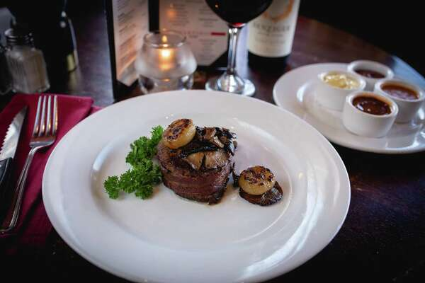 Above, bacon-wrapped filet served at Jim Barbarie's Black Angus in Danbury, highlights the restaurant's affinity for meat.