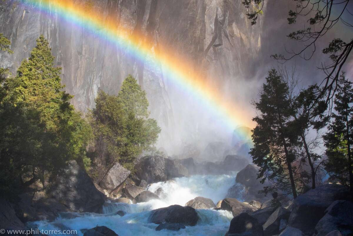 TV host and biologist Phil Torres shared a stunning photo of a rainbow at Yosemite Falls on April 25, 2019. Yosemite Falls is the highest waterfall in Yosemite National Park, dropping a total of 2,425 feet from the top of the upper fall to the base of the lower fall.