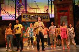 "The cast of Westport Country Playhouse's ""In the Heights"" features Didi Romero, left, Gerald Caesar, Edward Cuellar, Rodolfo Soto, Ezequiel Pujols, Randy Castillo, Nina Victoria Negron and Sarita Colon. The run has been extended through May 19."