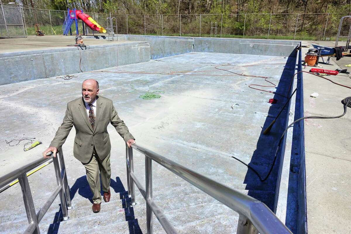 Troy Mayor Patrick Madden stands in the south Troy pool on Thursday, April 25, 2019, in Troy, N.Y. The mayor's office hope to have repairs completed in time for the pool to open this summer but on Friday acknowledged the work would not be finished in time. (Paul Buckowski/Times Union)