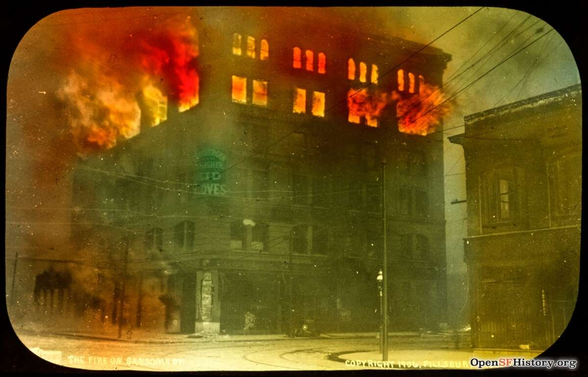 A fire rages at Second and Mission streets, the location of Thumler and Rutherford bookbinders, after the 1906 earthquake.