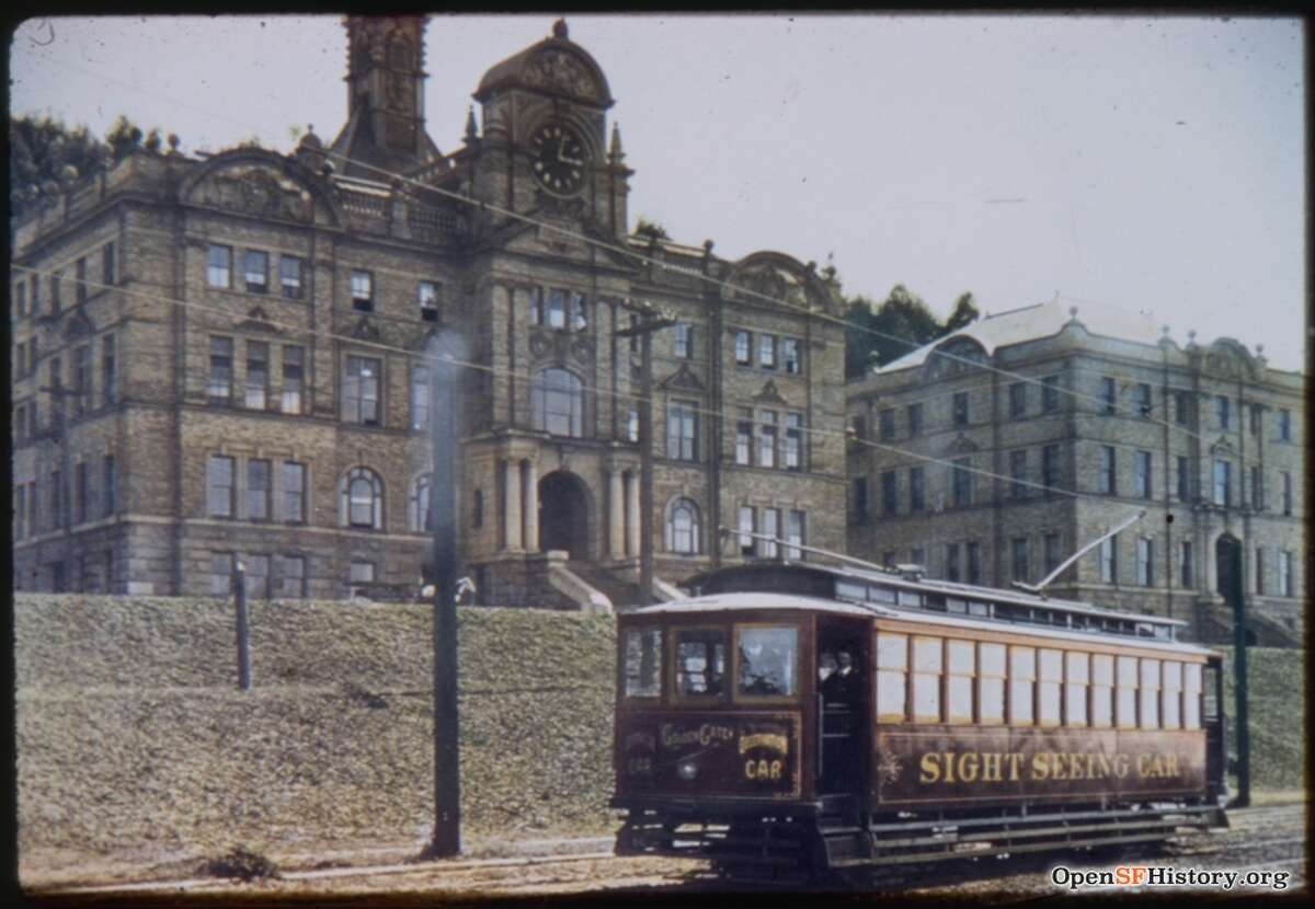 A sightseeing streetcar passes by Parnassus near Second in 1909. The photo was hand-colored by Charles Smallwood.