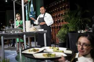 """Chef Johnny Hernandez, founder and President of Grupo La Gloria and True Flavors Inc., cooks during the San Antonio Restaurant Association's annual gala at the Witte Museum in October. Hernandez will appear on a May 9 episode of the Food Network show """"Beat Bobby Flay."""""""