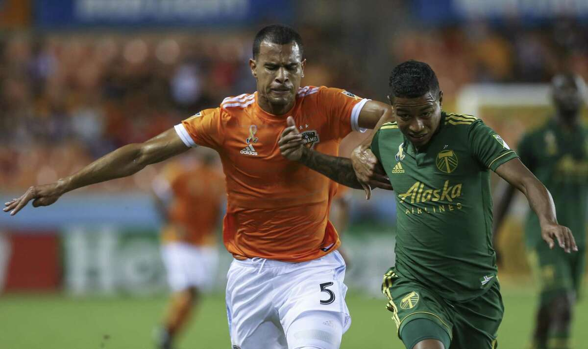 Houston Dynamo midfielder Juan David Cabezas (5) battles against Portland Timbers midfielder Andy Polo (11) during the second half of the MLS game at BBVA Compass Stadium on Saturday, Sept. 15, 2018, in Houston. The Houston Dynamo defeated the Portland Timbers 4-1.