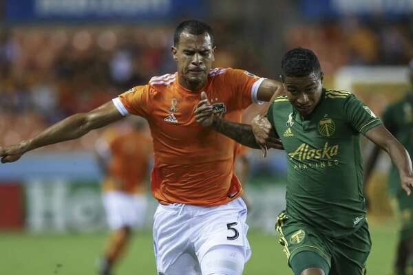 Dynamo midfielder Juan David Cabezas, competing against Portland's Andy Polo last year, was limited to six games in 2018 because of thigh injuries. Cabezas hopes to stayl healthy this season.