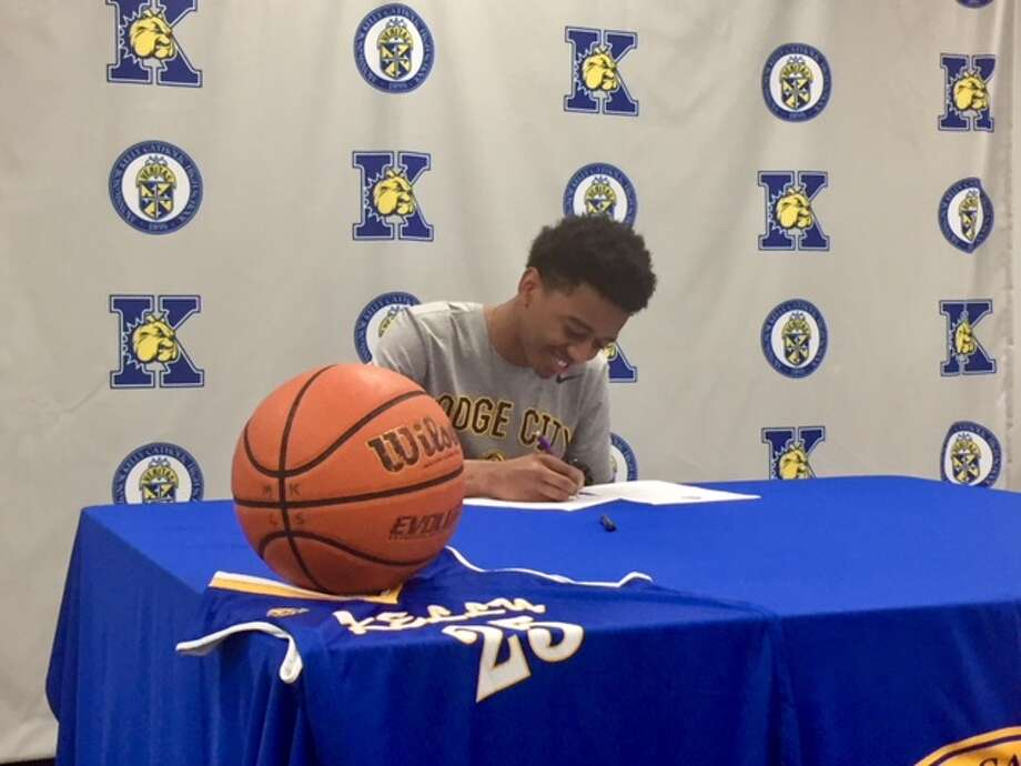 Kelly Catholic senior Chris May signs his National Letter of Intent on Thursday to play basketball at Dodge City Community College. Photo by Matt Faye/The Enterprise. Photo: Matt Faye