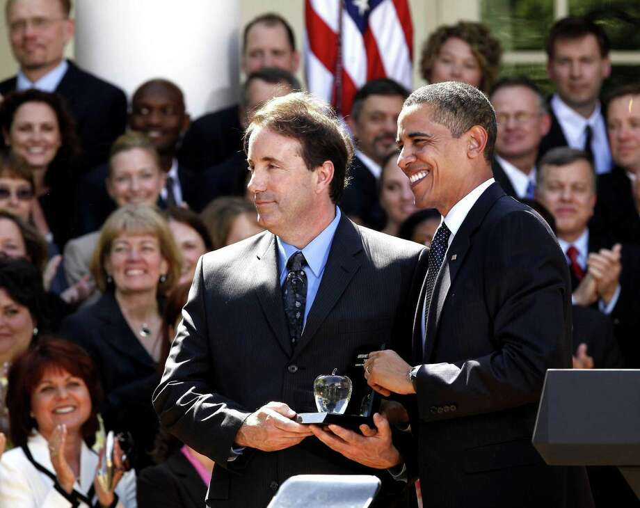 President Barack Obama introduces the 2009 National Teacher of the Year, Anthony Mullen of Greenwich, Conn., during a ceremony in the Rose Garden of the White House in Washington, Tuesday, April 28, 2009. Photo: Gerald Herbert / AP / AP