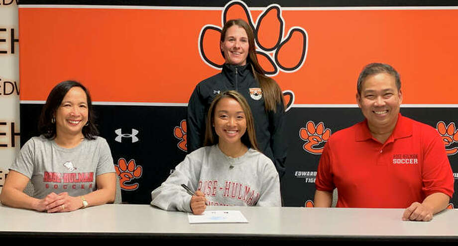 EHS senior Katrina Agustin, seated center with her parents, will play women's soccer at Rose-Hulman. Standing is Edwardsville girls' soccer coach Abby Federmann. Photo: Matt Kamp/The Intelligencer