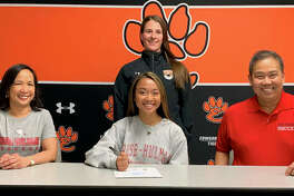 EHS senior Katrina Agustin, seated center with her parents, will play women's soccer at Rose-Hulman. Standing is Edwardsville girls' soccer coach Abby Federmann.