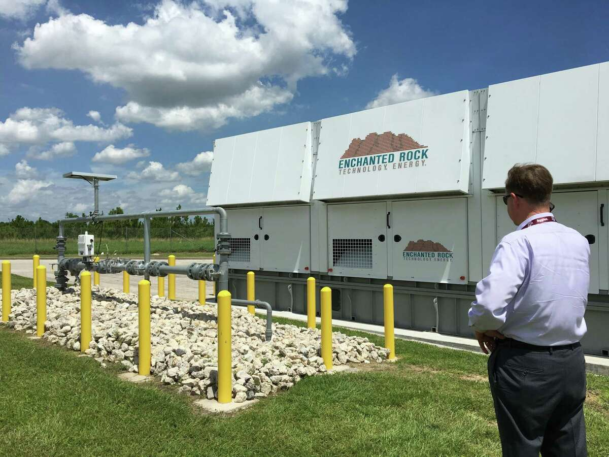 Thomas McAndrew, CEO of Enchanted Rock Energy, stands beside a natural gas generator installed at an HEB Grocery store in Houston, Texas. Enchanted Rock has developed new technology and a new business model that will make emergency generation more affordable for companies like HEB.