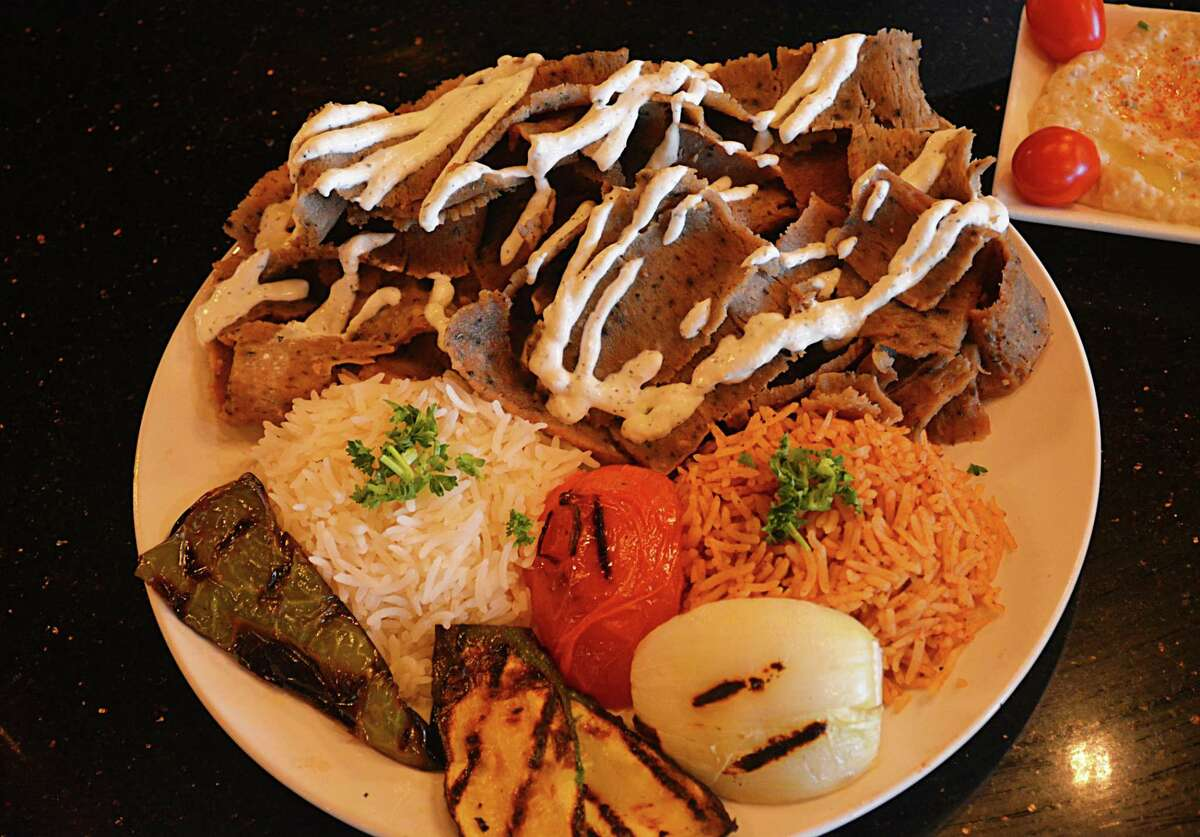 Gyro Love's gyro platter offers a choice of shaved beef/lamb or chicken topped with tzatziki cucumber sauce, with grilled vegetables, long-grain and brown rices. At far right is the restaurant's popular hummus dip.