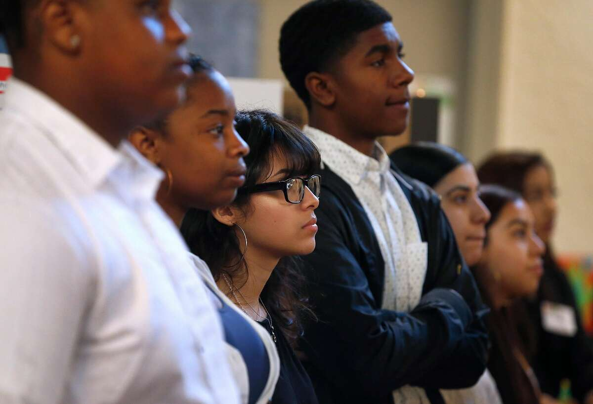 Emily Contreras (center) and members of her urban planning team from Oakland High, listens to a presentation on stage at the Y-PLAN Policy Summit for grade school students at the International House in Berkeley, Calif. on Thursday, April 25, 2019.