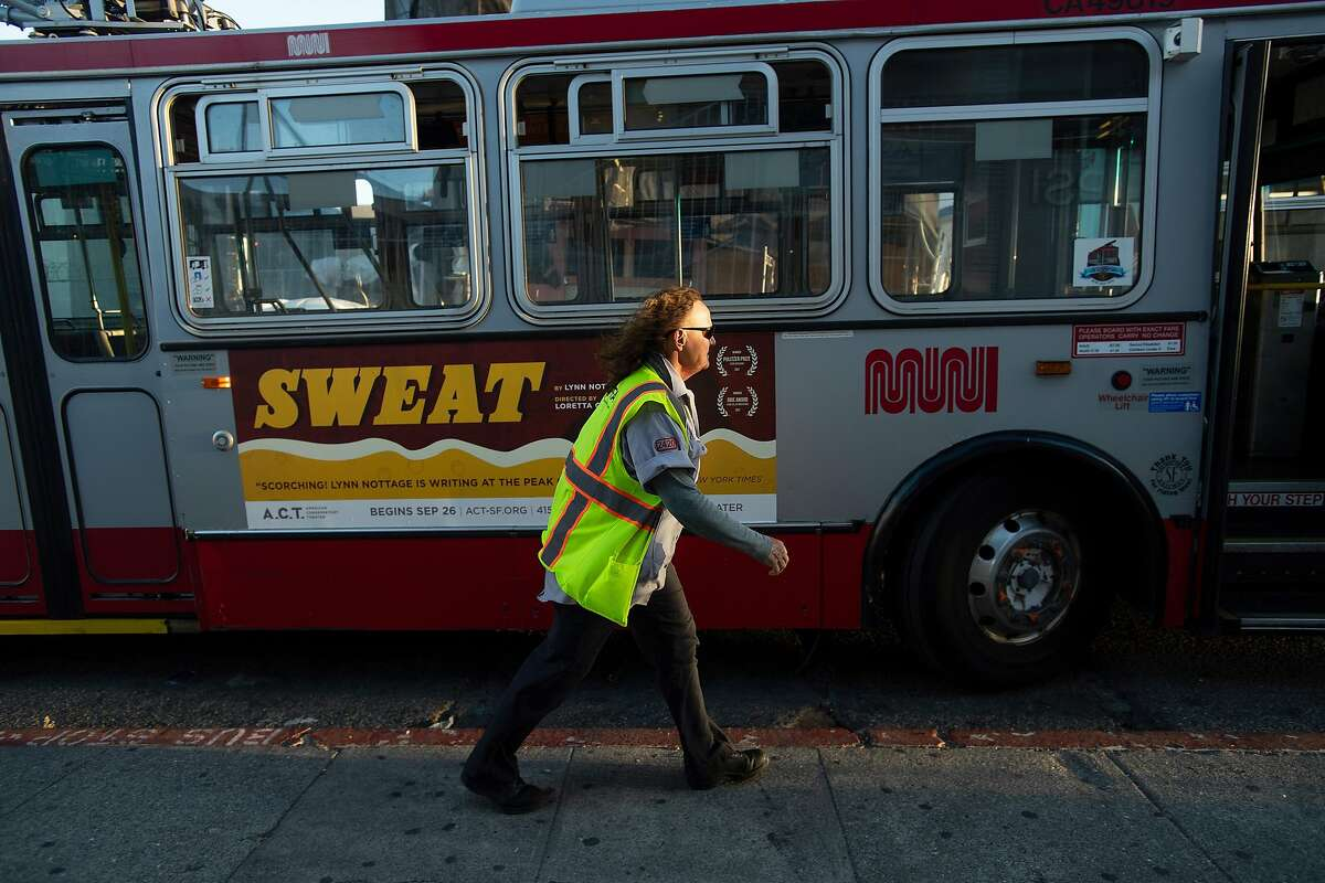 Muni driver Michelle Moore returns to her bus after a break on Thursday, Sept. 13, 2018, in San Francisco