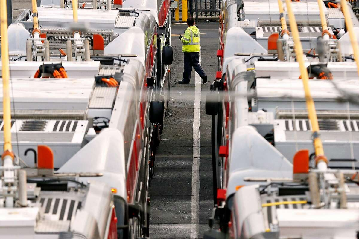 An officials inspects the buses at the MUNI Potrero Division yard on Wednesday, Dec. 5, 2018, in San Francisco, Calif.