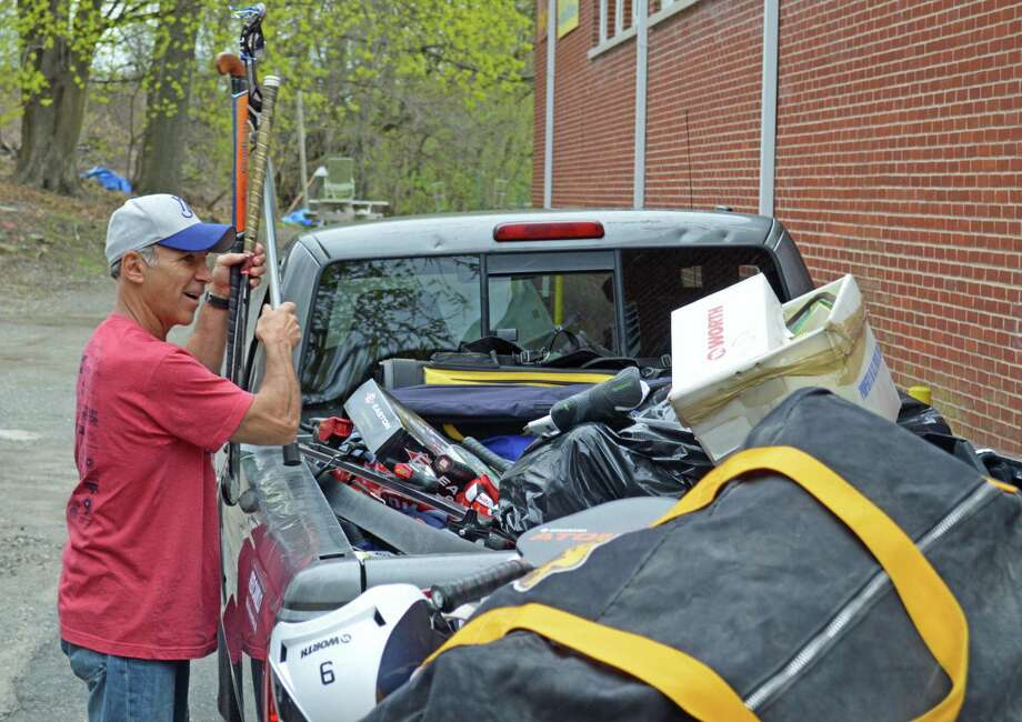 State Rep. Fred Camillo, R-Greenwich, with donations to his sports equipment drive to benefit the Greenwich Boys & Girls Club. Photo: Contributed Photo